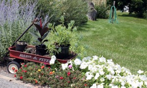 Garden Art will add flair to your herb container gardening.